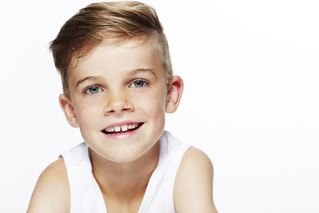 Portrait of young boy in vest, smiling
