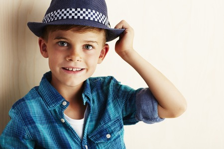 undone: Portrait of young boy checked shirt and hat, smiling