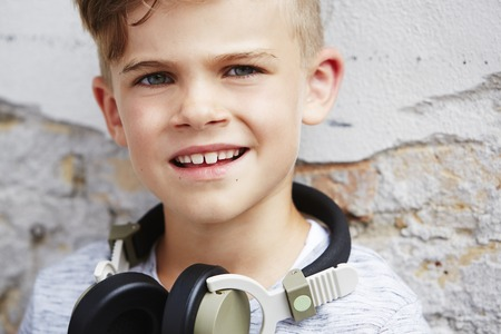 Portrait of young boy wearing headphones, close up photo