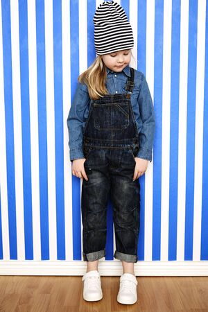 wooly: Blond girl in striped hat and dungarees