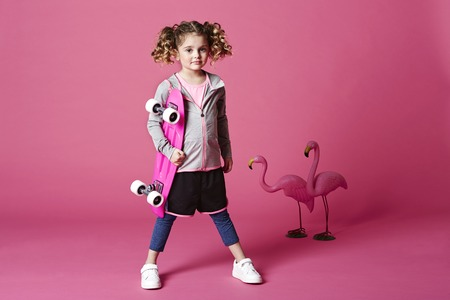 casual hooded top: Skater girl with board and flamingoes, portrait