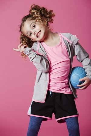 casual hooded top: Young girl holding football