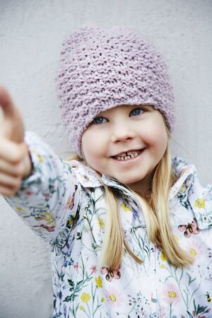 wooly: Cheerful girl in woolly hat and flowery coat