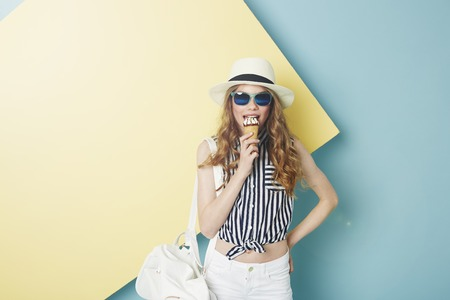 summer wear: Teenage girl in summer wear eating ice cream Stock Photo