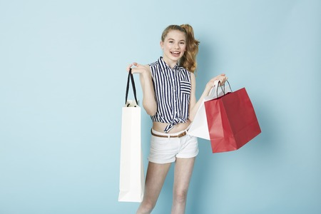 retail therapy: Joyful teenage girl with shopping bags