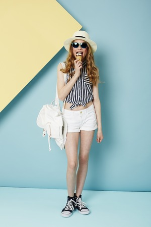 summer wear: Teenage girl in summer wear enjoying ice cream Stock Photo