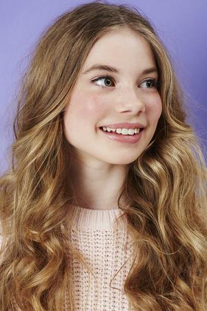 sweet sixteen: Blond teenage girl smiling in studio