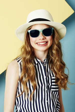 summer wear: Teenage girl in summer wear and sunglasses Stock Photo