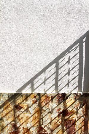 railing: Railing shadow on white wall Stock Photo
