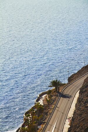 incidental people: High angle view of highway next to ocean Stock Photo