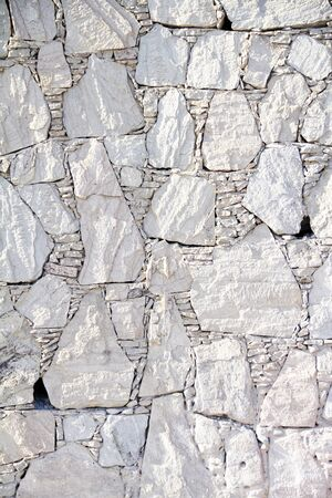 stoned: White stoned wall, close up