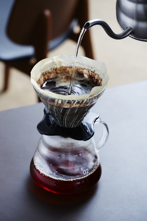 Pouring hot water into coffee maker