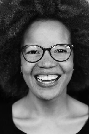close portrait: Laughing young woman in black and white image