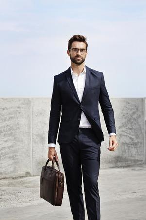open collar: Businessman walking with briefcase