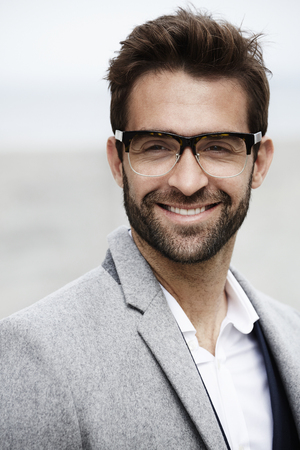 open collar: Businessman smiling in close up, portrait