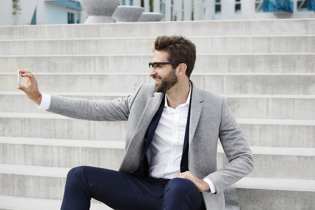 open collar: Businessman taking selfie on Smartphone