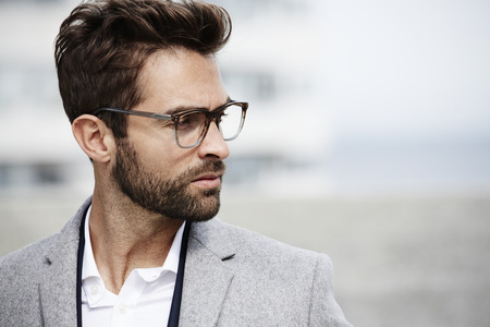 open collar: Spectacled businessman looking away Stock Photo