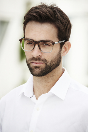 open collar: Serious man wearing spectacles
