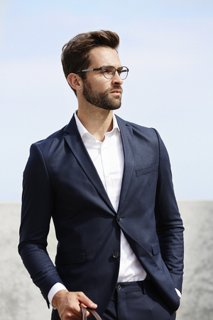 open collar: Posing businessman wearing spectacles