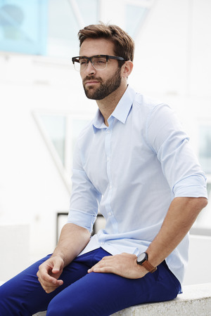 open collar: Serious man in blue fashion, looking away