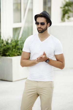 cool dude: Cool dude in white with shades and hat Stock Photo