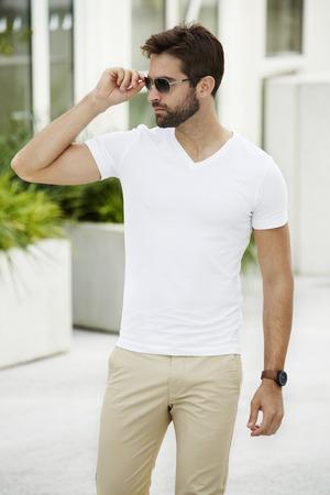 Cool guy adjusting sunglasses
