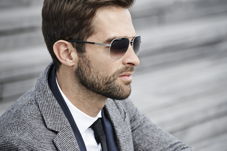 profile: Businessman in sunglasses, profile Stock Photo