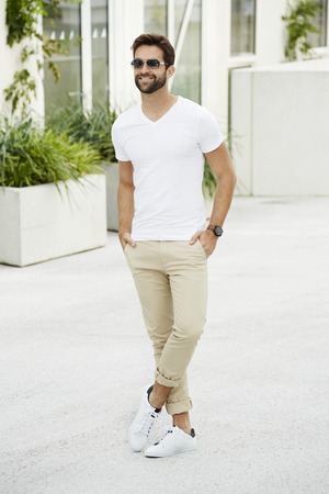 Smiling casual man standing outdoors