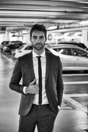 sharply: Sharply dressed man in parking lot, portrait