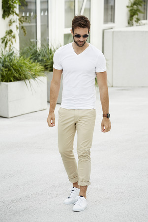 casually dressed: Walking casually dressed man in town Stock Photo