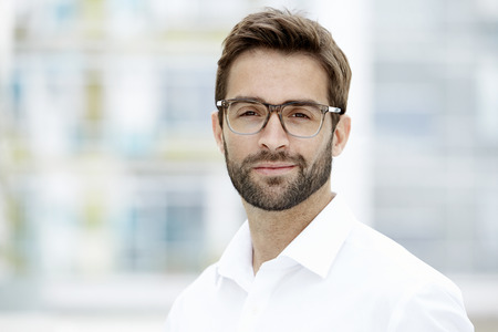 Confident man in glasses looking at camera