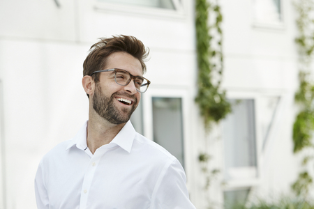 open collar: Laughing man in white shirt and glasses