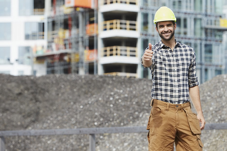 three day beard: Thumbs up construction worker, smiling