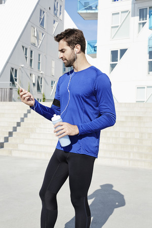 steps and staircases: Athlete choosing tunes on smartphone