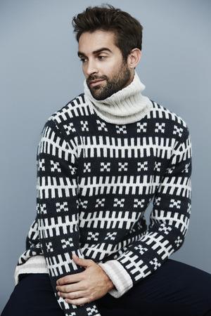 knitwear: Handsome man in knitwear, looking away Stock Photo