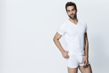 Man in white underpants posing for camera Stock Photo