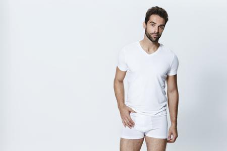 Man wearing white t-shirt and underpants, studio Stock Photo