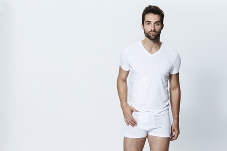 Guy in white underpants, looking at camera Standard-Bild