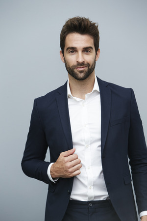 cool man: Bearded suit dude smiling at camera Stock Photo
