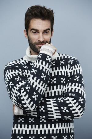 hand on the chin: Portrait of guy in sweater, hand on chin