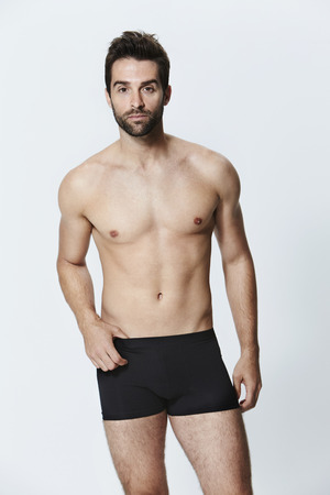 Man in black underwear shorts, portrait