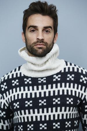 knitwear: Serious man knitwear posing for camera