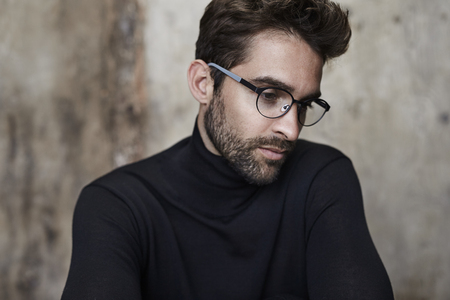 bookish: Bookish guy in black sweater and spectacles