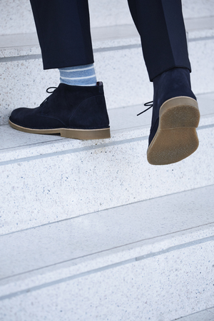 steps and staircases: Man walking upstairs in boots, close up