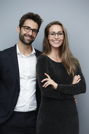 Glamorous couple smiling for camera