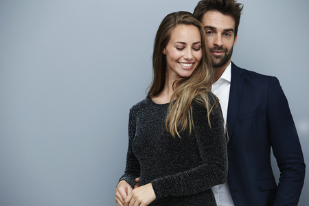 open collar: Sharp dressed couple in studio Stock Photo