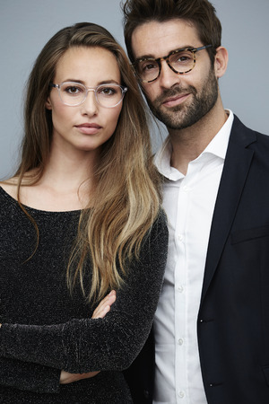open collar: Stunning couple in spectacles, portrait