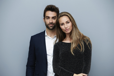 open collar: Stunning smartly dressed couple, portrait Stock Photo