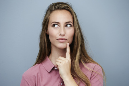 Beautiful woman in pink finding inspiration Standard-Bild