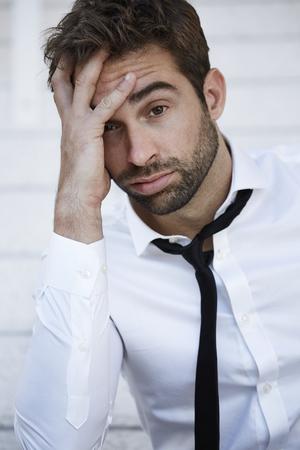 sad businessman: Sad businessman looking at camera, portrait Stock Photo